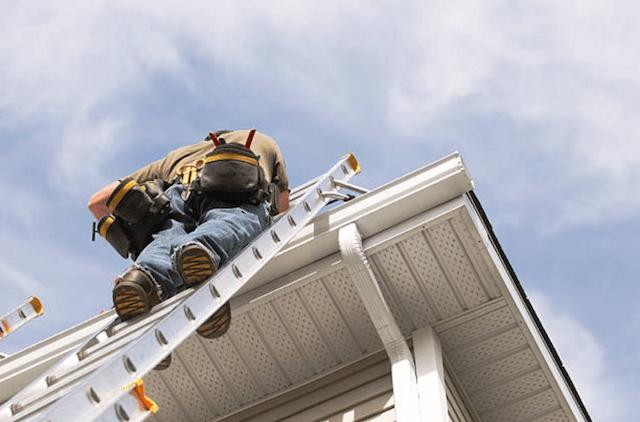 gutter cleaner on high ladder